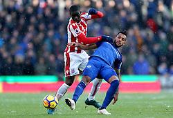 Stoke City's Badou Ndiaye (left) and Everton's Theo Walcott battle for the ball