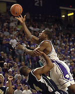 Kansas State forward Cartier Martin (R) drive to the basket over Georgia Southern's Sean Oliver (L), during the second half of the Wildcats 83-58 win over the Eagles at Bramlage Coliseum in Manhattan, Kansas, November 19, 2005.