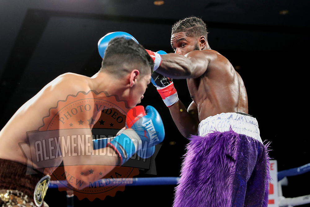 Anthony Soto (L) fights Isaiah Varnell during a One For All Promotions boxing event at the Caribe Royale Orlando Events Center on Saturday, February 20, 2021 in Orlando, Florida. (Alex Menendez via AP)