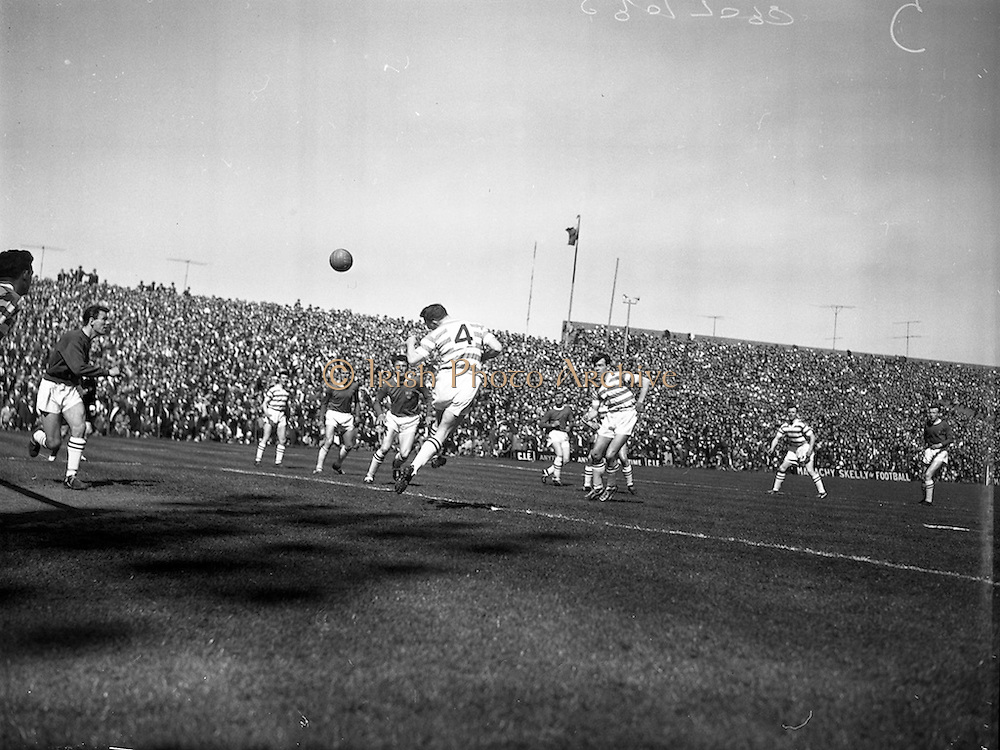 29/04/1962<br /> 04/29/1962<br /> 29 April 1962<br /> Shamrock Rovers v Shelbourne in the F.A.I. Cup Final at Dalymount Park, Dublin. Shamrock Rovers right half, Nolan heads the ball outside the bar for a corner kick.