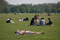 © licensed to London News Pictures. London, UK 22/05/2012. People enjoying sunshine in Hyde Park today as the sunshine and hot weather comes to London (22/05/12). Photo credit: Tolga Akmen/LNP