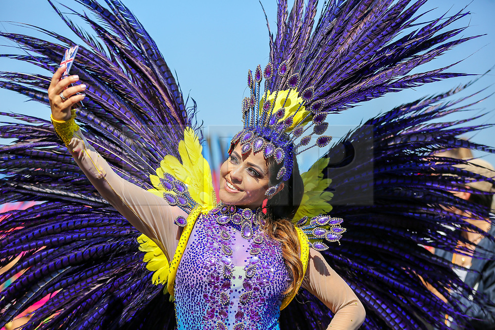 © Licensed to London News Pictures. 26/08/2019. London, UK. A dancer takes a selfie on the second day of Notting Hill Carnival in west London. Thousands of revellers take part in Notting Hill Carnival, Europe's largest street party and a celebration of Caribbean traditions and the capital's cultural diversity. Photo credit: Dinendra Haria/LNP