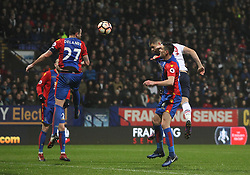 Jamie Proctor of Bolton Wanderers (R) heads at goal - Mandatory by-line: Jack Phillips/JMP - 07/01/2017 - FOOTBALL - Macron Stadium - Bolton, England - Bolton Wanderers v Crystal Palace - FA Cup Third Round