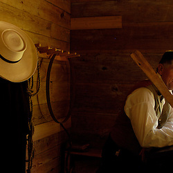 EXPLORE PARK Dave Smoot, a 19th century schoolmaster, leans on his paddle, a popular disciplinary tool of those times.  Explore Park recreates American life from early native American up until the 19th century.