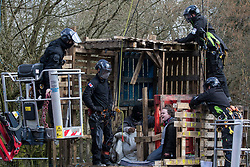 Bailiffs from the National Eviction Team (NET) work to remove activists opposed to the HS2 high-speed rail link from a makeshift tower in Denham Country Park where they had been seeking to delay electricity pylon relocation works by Babcock in connection with the rail project on 22nd March 2021 in Denham, United Kingdom. Activists continue to oppose the controversial infrastructure project from a series of protest camps along its Phase 1 route between London and Birmingham.