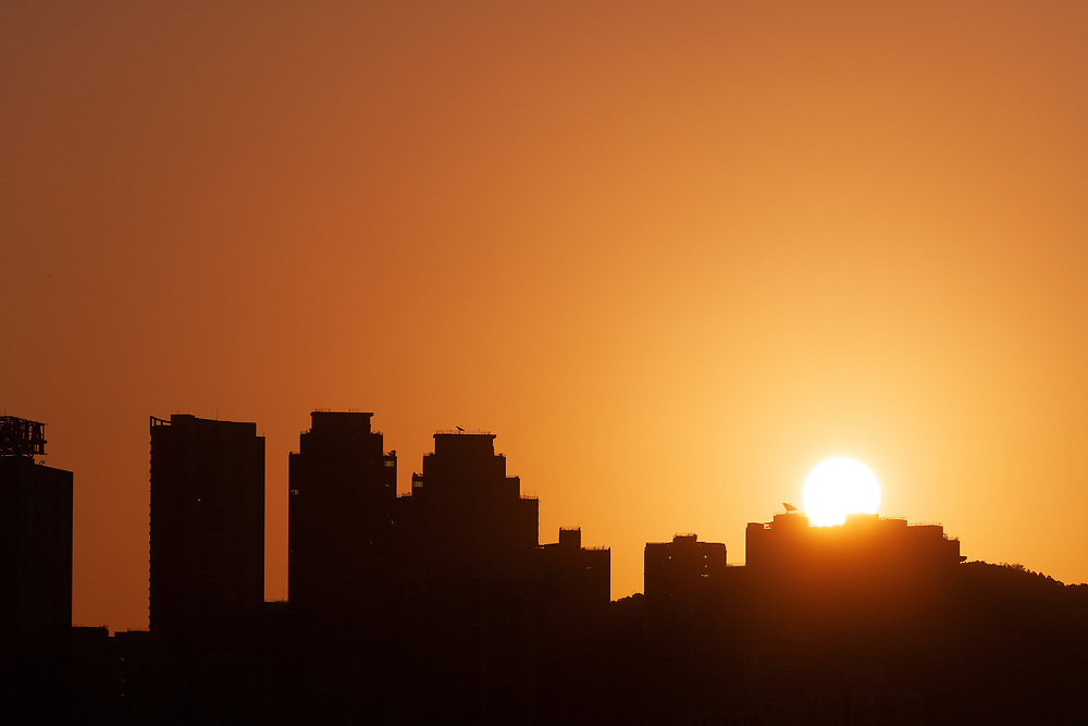 Sunrising behind the silhouetted skyline of Hong Kong, China