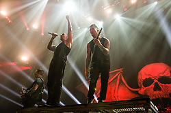 © Licensed to London News Pictures. 01/12/2013. London, UK.   Avenged Sevenfold performing live at Wembley Arena. In this pic - M.Shadows (centre), Synyster Gates (right).The band is also known as A7X and consists of members M. Shadows (lead vocals), Zacky Vengeance (rhythm guitar/vocals),  Synyster Gates (lead guitar/vocals),Johnny Christ (bass) and Arin Ilejay (drums).  Photo credit : Richard Isaac/LNP