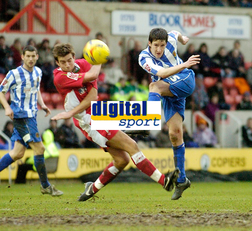 Photo: Leigh Quinnell.<br /> Swindon Town v Chester City. Coca Cola League 2. 24/02/2007. Chesters Alan Kearney gets a shot on goal past Swindons Michael Pook.