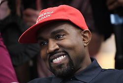 """File photo of Artist Kanye West looks on in the Oval Office of the White House during a meeting with President Trump to discuss criminal justice system and prison reform on October 11, 2018 in Washington, DC. Kim Kardashian West spoke out about Kanye West's bipolar disorder Wednesday, three days after the rapper delivered a lengthy monologue at a campaign event touching on topics from abortion to Harriet Tubman, and after he said he has been trying to divorce her.Kardashian West said in a statement posted in an Instagram Story that she has never spoken publicly about how West's bipolar disorder has affected their family because she is very protective of their children and her husband's """"right to privacy when it comes to his health."""" Photo by Olivier Douliery/ Abaca Press"""