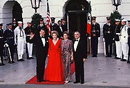 President Ronald Reagan and First Lady Nancy Reagan President De La Madrid  and Paloma Cordero Tapia of Mexico at the North Portico of the White House for a state dinner on May 15, 1984<br /> Photo by Dennis Brack
