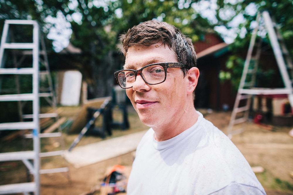 Schuyler Silva of SQFT Studios, at work on a backyard studio in Portland, OR