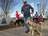 "Bob and his Berger Picard ""BO"" head out onto the WOW Trail for Saturday's Bow Wow Fest at Opechee Inn and Spa.  (Karen Bobotas/for the Laconia Daily Sun)"