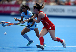 England's Laura Unsworth and India's Vandana Katariya (left) during the Vitality Women's Hockey World Cup pool B match at The Lee Valley Hockey and Tennis Centre, London.