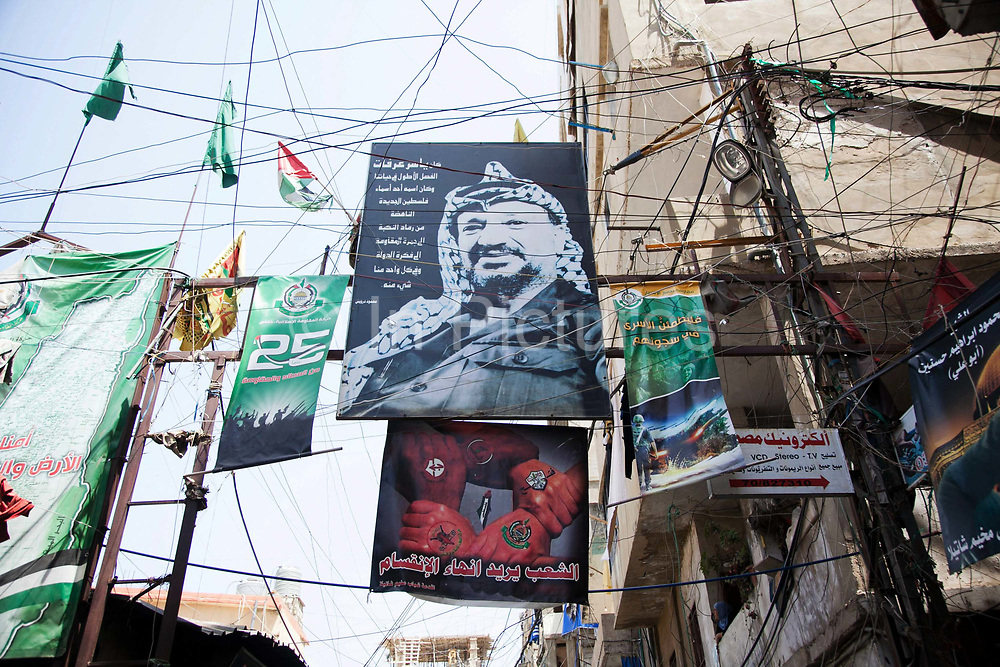 A poster the late Palestinian PLO leader Yassir Arafat hangs high above electric wires in the streets of Shatila. Shatila is a Palestinian refugee camp in Beirut and the home to thousands of Palestinians who have lived in the camp for decades. The camp is known world wide as a place where Lebanese militia supported by Israeli forces killed thousands of Palestinians.