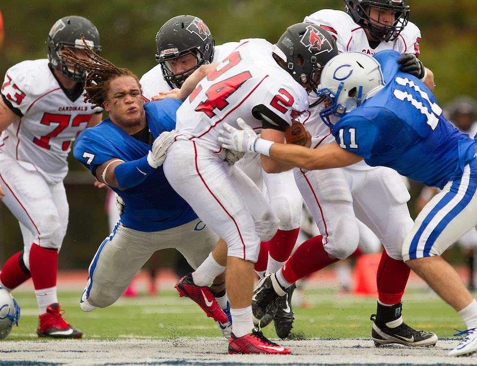Ryan Ruiz and Tony Atkinson, of Colby College, during a NCAA Division III football game on October 4, 2014 in Waterville, ME. (Dustin Satloff/Colby College Athletics)