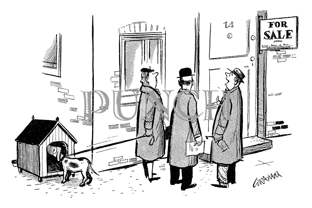 (A couple are shown round a potential new home whilst their dog inspects an adjoining kennel)