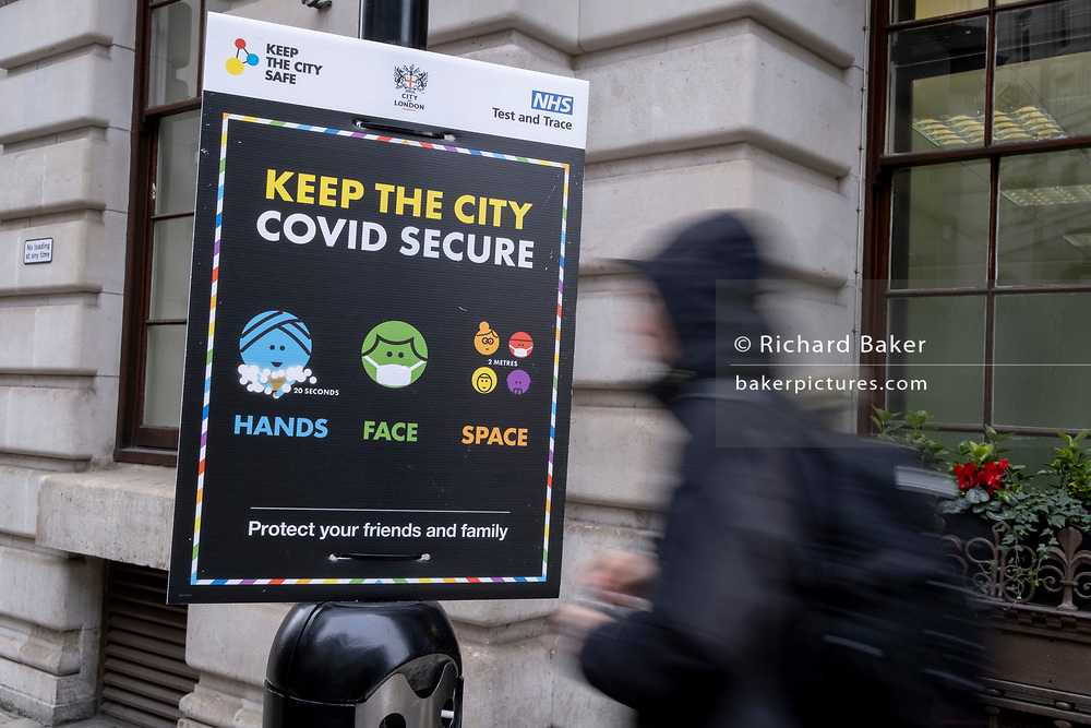 As the UK government tells the nation to prepare for the worst two weeks of the Coronavirus pandemic, a warning aimed at the population to stay at home and minimise contact with others, but in the week when new vaccination centres are opening, is a warning for the public to stay safe, on 11th January 2021, in the City of London, England.