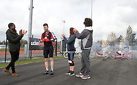 Blue Peter presenters have gone head-to-head on their personally modified bikes in a cycle race for Sport Relief 2014. Ore Oduba, left, presents Barney Harwood with the gold medal.  Lindsey Russell, centre, and Radzi Chinyanganya, right, were disqualified from the race.<br /> <br /> Photo by Chris Vaughan/CameraSport<br /> <br /> Commercial - Sport Relief -  publicity shoot - Tuesday 4th March 2014 - University of Central Lancashire Sports Arena - Preston<br /> <br /> © CameraSport - 43 Linden Ave. Countesthorpe. Leicester. England. LE8 5PG - Tel: +44 (0) 116 277 4147 - admin@camerasport.com - www.camerasport.com