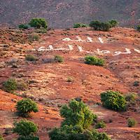 Africa, Morocco. Arabic message on foothills of Atlas mountain range.