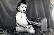 portrait of little child with toy piano 1932