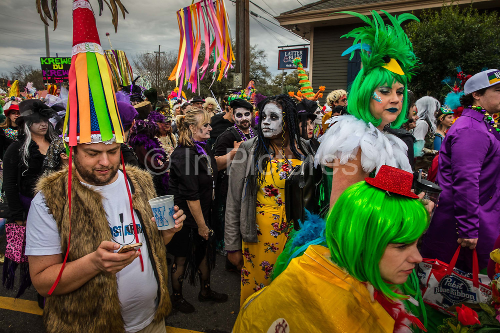 The Society of Saint Anne on parade during Mardi Gras on 25th February 2020 in Bywater district of New Orleans, Louisiana, United States. Mardi Gras is the biggest celebration the city of New Orleans hosts every year. The magnificent, costumed, beaded and feathered party is laced with tradition and  having a good time. Celebrations are concentrated for about two weeks before and culminate on Fat Tuesday the day before Ash Wednesday and Lent.