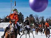 U.S. Polo Assn., in orange, and Richard Mille play in the final game at Rio Grande Park during the St. Regis World Snow Polo Championships in Aspen, Colorado.