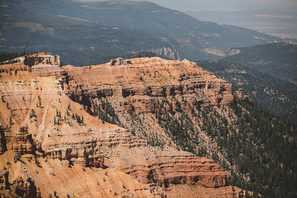 The craggy landscape of ancient rock formations seen on a hot summer morning at Cedar Breaks in Utah.