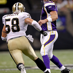 September 9, 2010; New Orleans, LA, USA; Minnesota Vikings quarterback Brett Favre (4) is pressured by New Orleans Saints linebacker Scott Shanle (58) during the NFL Kickoff season opener at the Louisiana Superdome. The New Orleans Saints defeated the Minnesota Vikings 14-9.  Mandatory Credit: Derick E. Hingle