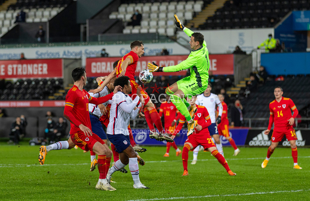 SWANSEA, WALES - Thursday, November 12, 2020: Wales' goalkeeper Daniel Ward jumps for a cross during an International Friendly match between Wales and the USA at the Liberty Stadium. (Pic by David Rawcliffe/Propaganda)