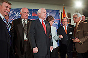 15 FEBRUARY 2010 -- TEMPE, AZ: Sen John McCain (CENTER RED TIE) waits for mayors from Arizona cities to get in place around him for a photo after a press conference at American Legion Hall Post 2 in Tempe Monday morning. McCain introduced more than 30 mayors from across Arizona that have or will be endorsing him in his primary against former TV sports anchor and Congressman J.D. Hayworth. Hayworth, an arch conservative, is running against McCain for being too liberal on spending and immigration.     PHOTO BY JACK KURTZ