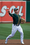 Oakland Athletics third baseman Matt Chapman (26) fields a ball against the Los Angeles Angels at Oakland Coliseum in Oakland, California, on September 6, 2017. (Stan Olszewski/Special to S.F. Examiner)