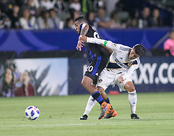 May 25, 2018 - Carson, California, U.S - Jonathan dos Santos #8 of the LA Galaxy battles for the ball with Anibal Godoy #20 of  the San Jose Earthquakes during their MLS game on Friday May 25, 2018 at the StubHub Center in Carson, California. LA Galaxy defeats the Earthquakes, 1-0. (Credit Image: © Prensa Internacional via ZUMA Wire)