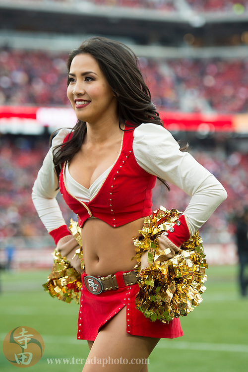 January 3, 2016; Santa Clara, CA, USA; San Francisco 49ers Gold Rush cheerleader Mika performs during halftime against the St. Louis Rams at Levi's Stadium. The 49ers defeated the Rams 19-16.