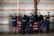 Members of the Owen Valley High School Air Force JROTC, left to right, Morgan Chaney, Zach Manley, Bailey Fears, Clay McBride, Kevin Delp and Ryan Scully wait to complete the flag folding ceremony in honor of Brett Wood, a US Army solider, who was killed in Afghanistan one year ago, during a ceremony at the Owen County Fairgrounds. (Photo by Jeremy Hogan)
