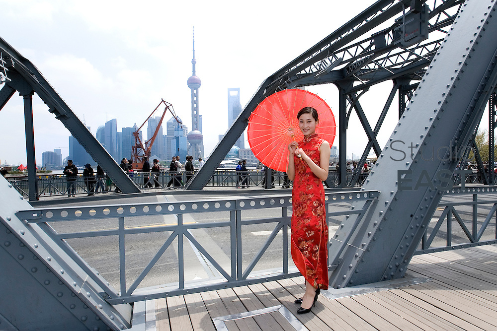 CHEN Nana, a hostess for GL events, poses for a photograph on the Waibaidu bridge, in Shanghai, China, on April 18, 2010. Chen Nana is 22-year-old and comes from Anhui province in China. Photo Lucas Schifres/Pictobank