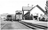 """Silverton Mixed on main line in front of the Durango depot.  San Juan has arrived earlier but still needs to be turned.<br /> D&RGW  Durango, CO  ca. 1950<br /> In book """"Durango: Always a Railroad Town (1st ed.)"""" page 34"""