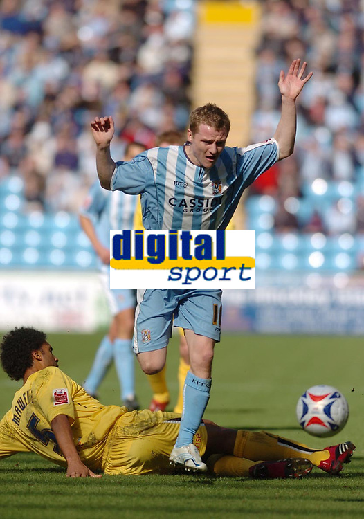 Photo: Leigh Quinnell.<br /> Coventry City v Preston North End. Coca Cola Championship. 01/04/2006. Coventrys Gary McSheffrey is brought to ground by Prestons Youl Mawene.
