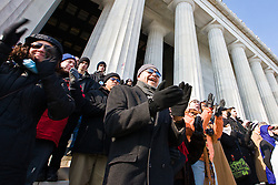 Crowd watching inauguration of Barack Obama from front steps of Lincoln Memorial, Washington D.C., USA.