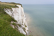 A hilltop landscape of England's iconic White Cliffs, under threat from chalk and soil erosion, on 27th July, in St Margaret's at Cliffe, in Kent, England.