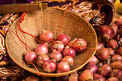 Asia, Myanmar (also known as Burma), Bagan, basket of onions in market