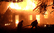 Firefighters battle a fire that destroyed a house Wednesday night, May 2, 2018, in Rosemead, California.(Photo by Ringo Chiu)<br /> <br /> Usage Notes: This content is intended for editorial use only. For other uses, additional clearances may be required.