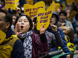 October 10, 2018 - Seoul, Gyeonggi, South Korea - A South Korean woman shouts during the Wednesday Demonstration to protest Japan's sexual enslavement of Korean women during World War II. The Wednesday protests have been taking place since January 1992. Protesters want the Japanese government to apologize for the forced sexual enslavement of up to 400,000 Asian women during World War II. The women, euphemistically called ''Comfort Women'' were drawn from territories Japan conquered during the war and many came from Korea, which was a Japanese colony in the years before and during the war. The ''comfort women'' issue is still a source of anger of many people in northeast Asian areas like South Korea, Manchuria and some parts of China. (Credit Image: © Jack Kurtz/ZUMA Wire)