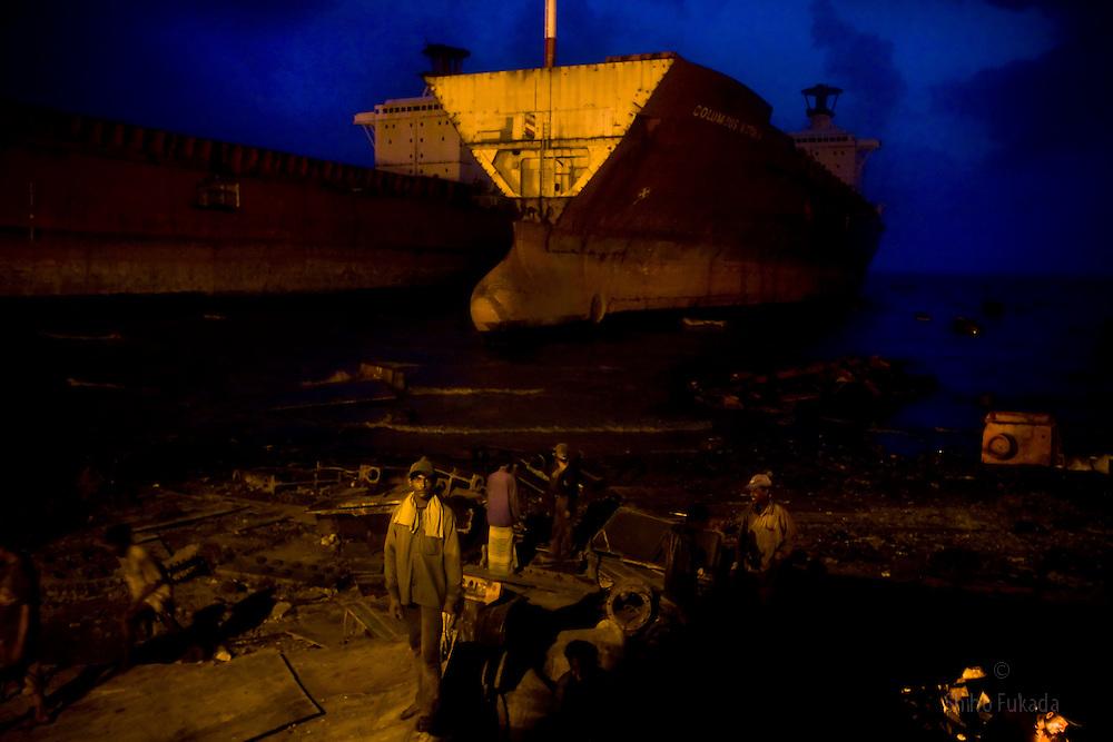 Labors work in a ship breaking yard in Chittagong, Bangladesh.