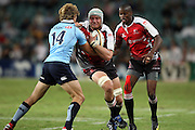Lions Franco Van Der Merwe runs at Lachie Turner. Super 14 Rugby Union, Waratahs v Lions, Sydney Football Stadium, Australia. Friday 12 March 2010. Photo: Clay Cross/PHOTOSPORT