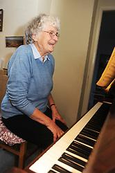 Elderly woman playing piano