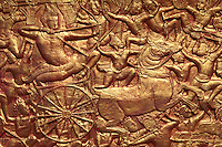 """Bas relief warriors at Wat Phnom - which means """"Temple of the Mountains"""" or """"Mountain Pagoda"""".  Wat Phnom is a Buddhist temple in Phnom Penh, and the namesake for that city."""