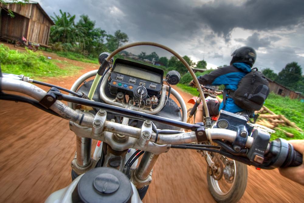 Tourists ride Baja 250 motorbikes through Mondulkiri Province, Cambodia