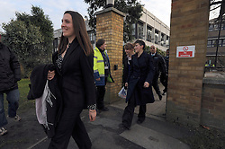 © Licensed to London News Pictures. 30/01/2012, Staines, UK. Three protesters leave via a side gate after being questioned by police. 6 activists have barricaded themselves into meeting rooms on two floors of British Gas offices in Staines, Middlesex, as part of the 'Winter Warm-Up' weekend called by the campaign group Fuel Poverty Action. British Gas is being targeted as one of the Big Six energy companies making profits out of rising energy bills.   Photo credit : Stephen Simpson/LNP