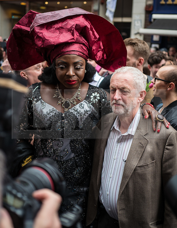 © Licensed to London News Pictures. 13/06/2016. London, UK. Jeremy Corbyn MP, Leader of the Labour Party, poses with a drag queen on Old Compton Street in Soho during a vigil to pay tribute to the victims of the Pulse nightclub massacre in Orlando, Florida. In the early hours of 12 June 2016, 29-year-old Omar Mateen entered Pulse, a gay nightclub, and killed more than 50 people with an assault rifle, making it the deadliest mass shooting in US history. Photo credit: Rob Pinney/LNP