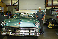 Denis Finnerty stands next to a 1955 Ford Customline at Finn's Garage in Meredith.    (Karen Bobotas/for the Laconia Daily Sun)